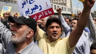 Des Iraniens protestent contre Donald Trump et sa décision de se retirer de l'accord sur le nucléaire à Téhéran, le 11 mai 2018.