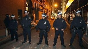 New York police block a street after removing protestors from New York's Zuccotti Park