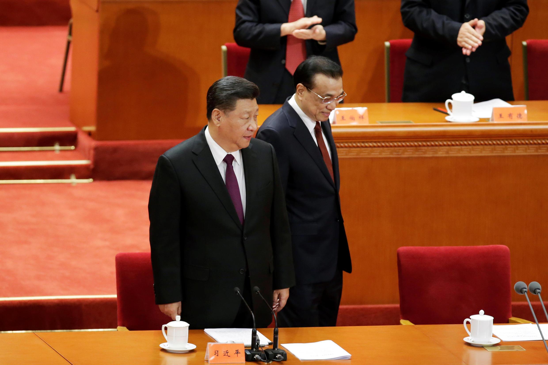 12月18日,中國國家主席習近平與中國國務院總理李克強在紀念改革40周年大會上。