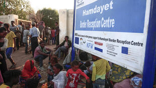 Ethiopian migrants who fled intense fighting in the Tigray region gather in the border reception centre of Hamdiyet in Sudan's eastern Kassala State on November 14, 2020