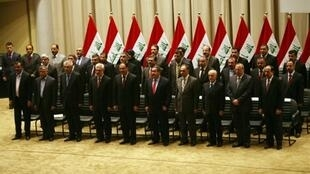 Iraqi PM Nuri Al-Maliki (first row, right) and his new government, 21 December
