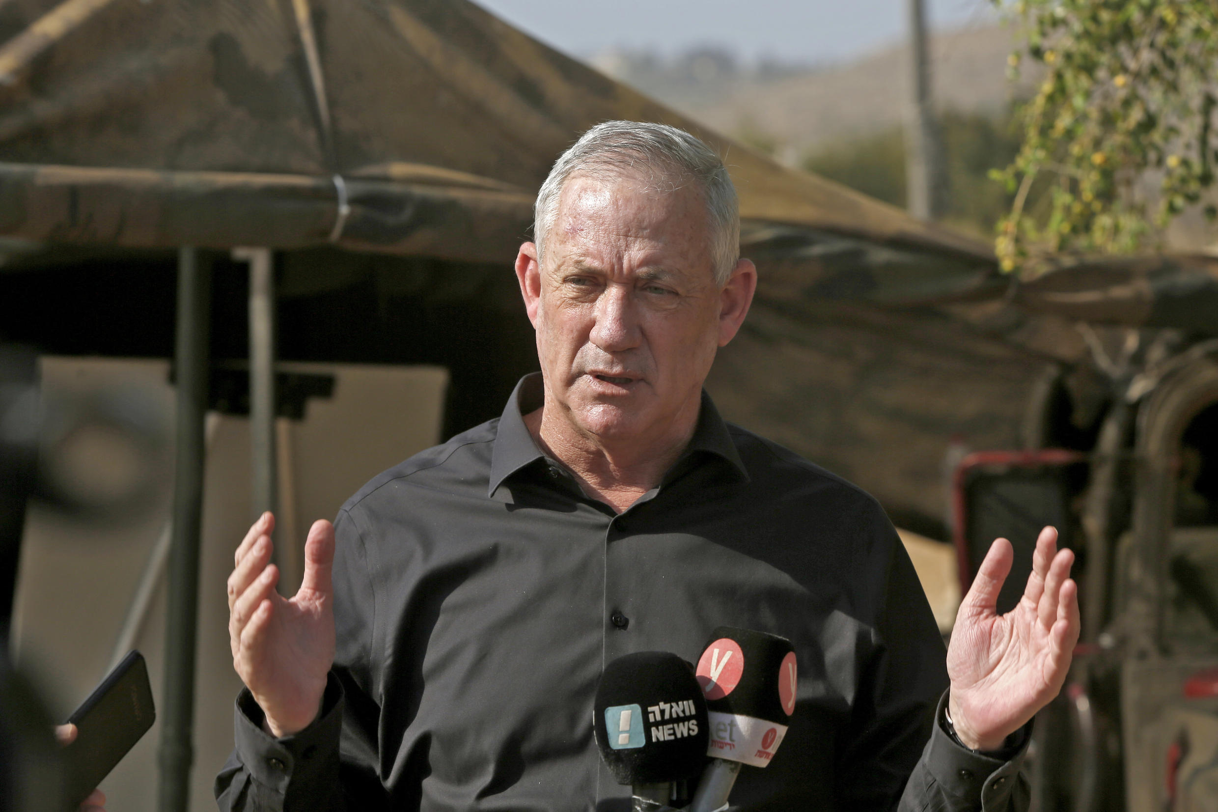 Israeli Defence Minister Benny Gantz speaks to the media during a military drill near Kibbutz Ravid in the northern part of Israel on October 27, 2020
