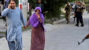 People leave the site of a powerful blast in Kabul, Afghanistan July 28, 2019.