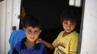 Enfants syriens dans un camp de réfugiés en Jordanie.