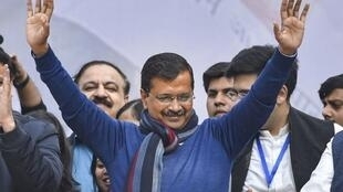 Arvind Kejriwal, AAP chief minister, greeting crowds after his victory in Delhi.