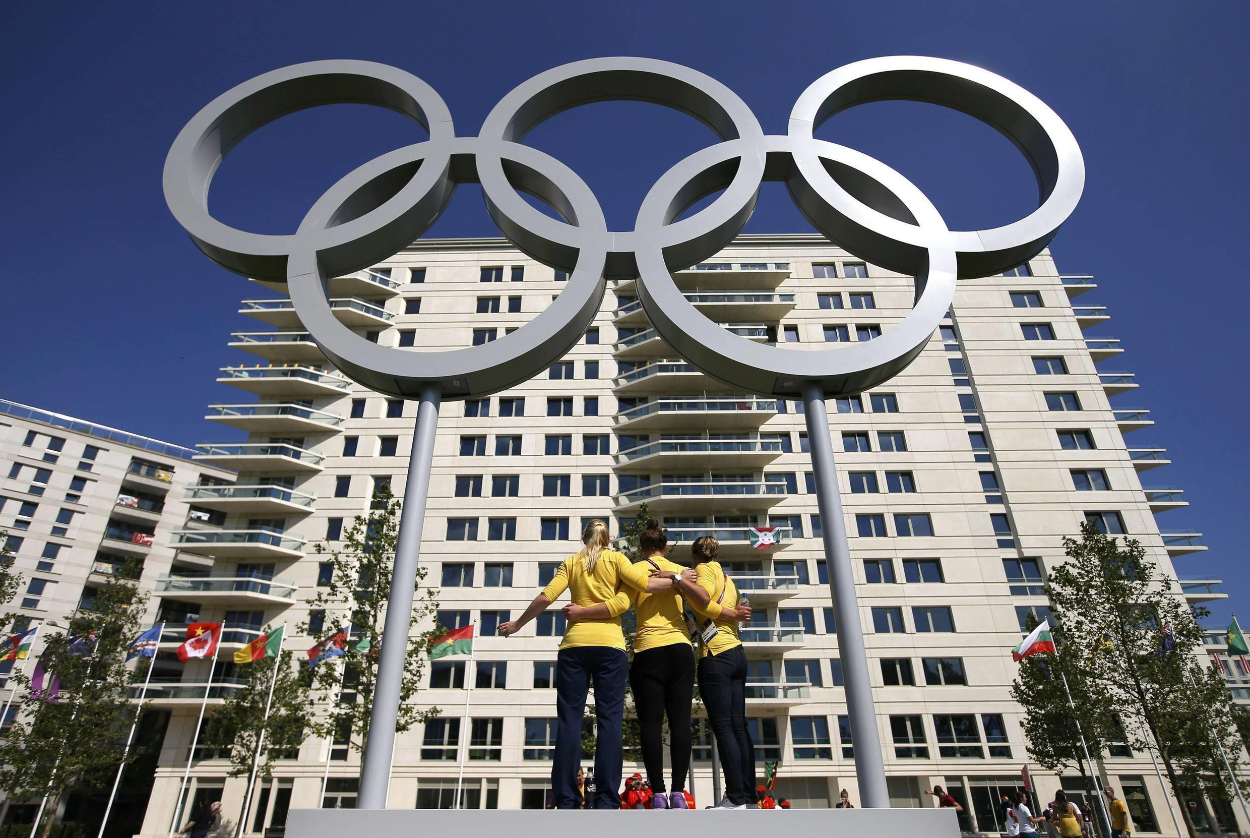 Australian swimmers with the Olympic rings at the Athletes' Village at the Olympic Park in London