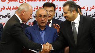 Renault's Thierry Bollore (L), Mansour Moazami, IDRO chairman (C) and Kourosh Morshed Solouk, deputy director of the Iranian Automobile Importers Association at the signing