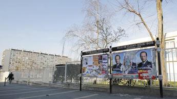 Cartazes com os candidatos à eleição na França.