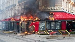 The upmarket Le Fouquet's restaurant on the Champs-Elysées Avenue burns on 16 March, 2019.