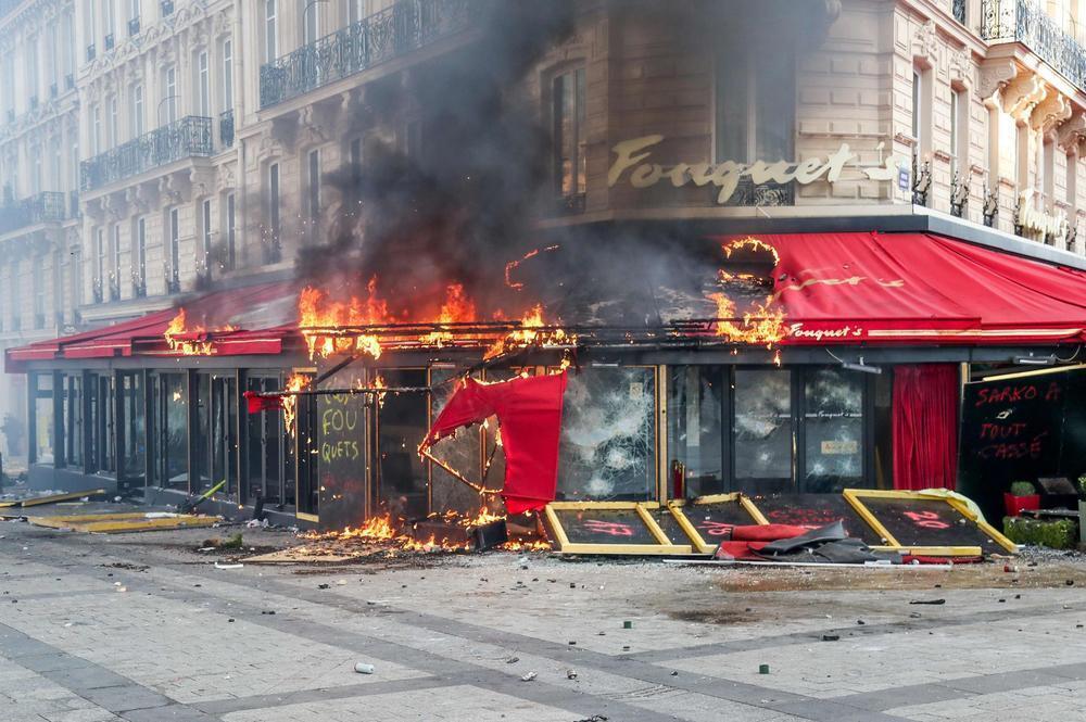The upmarket Le Fouquet's restaurant on the Champs-Elysées Avenue burns on 16 March, 2019.