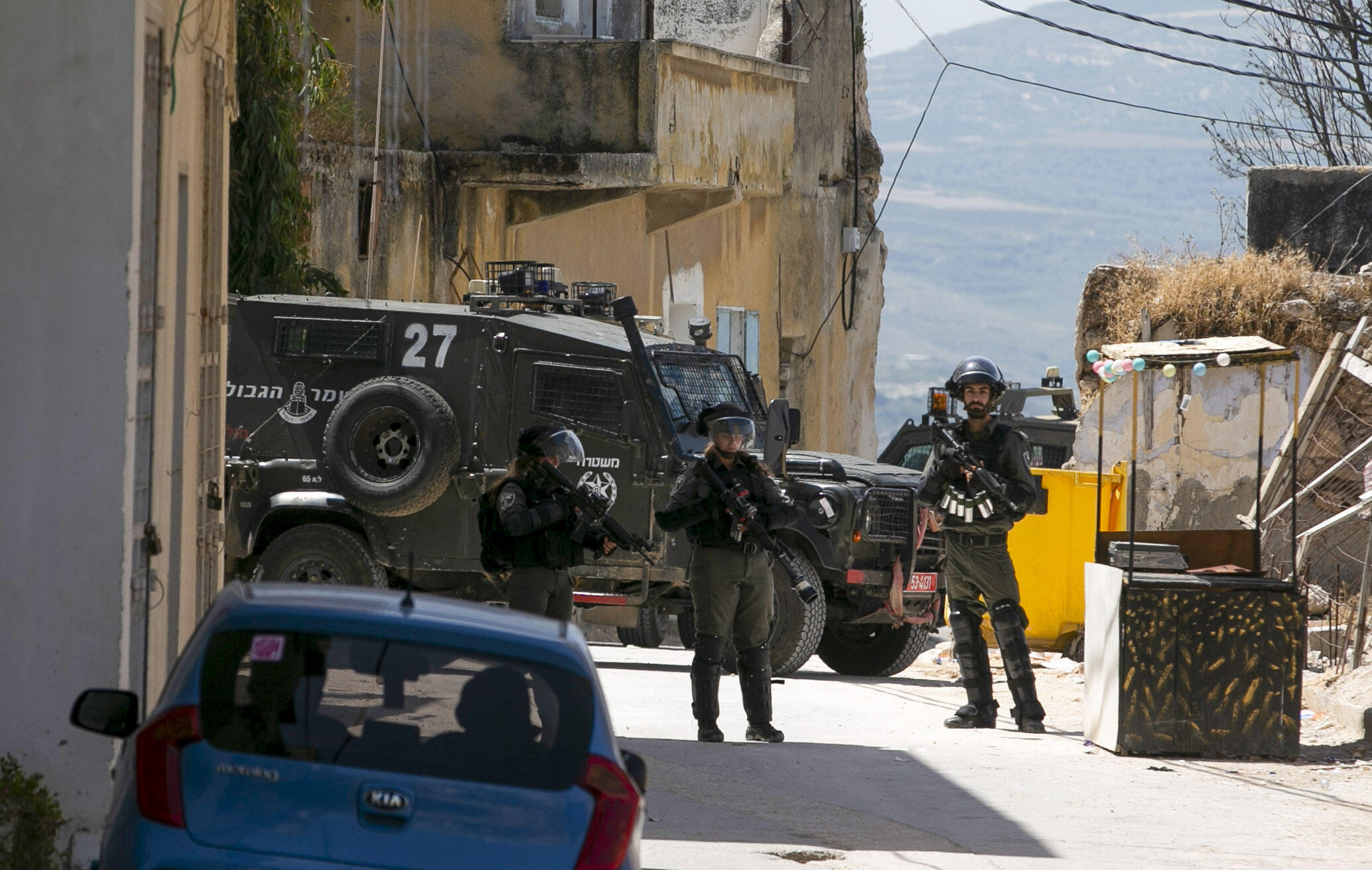 Israeli soldiers hunt for the Palestinian stonethrower believed to be responsible for the death of a comrade during an arrest operation in the village of Yaabad in the occupied West Bank