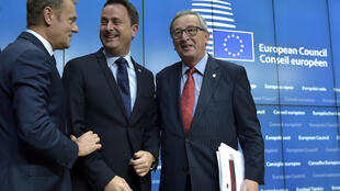 Luxembourg's Prime Minister Xavier Bettel and European Commission President Jean-Claude Juncker chat with European Council President Donald Tusk in Brussels on Friday.