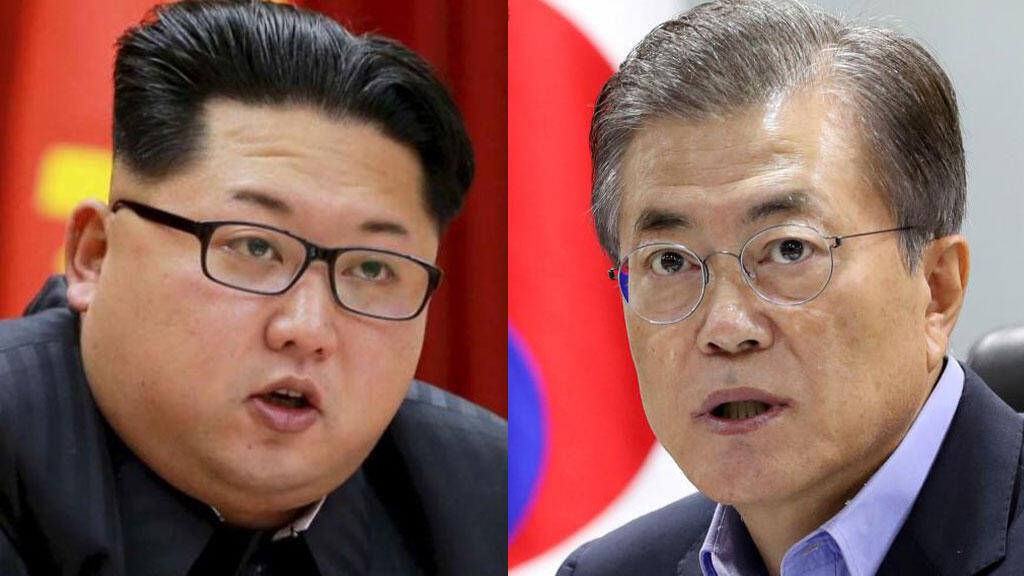 O líder norte-coreano Kim Jong-un (esq) e o presidente sul-coreano, Moon Jae-in.