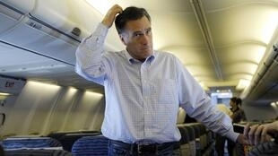 Republican presidential candidate Mitt Romney on his campaign plane in Jacksonville, Florida, 30 January, 2012