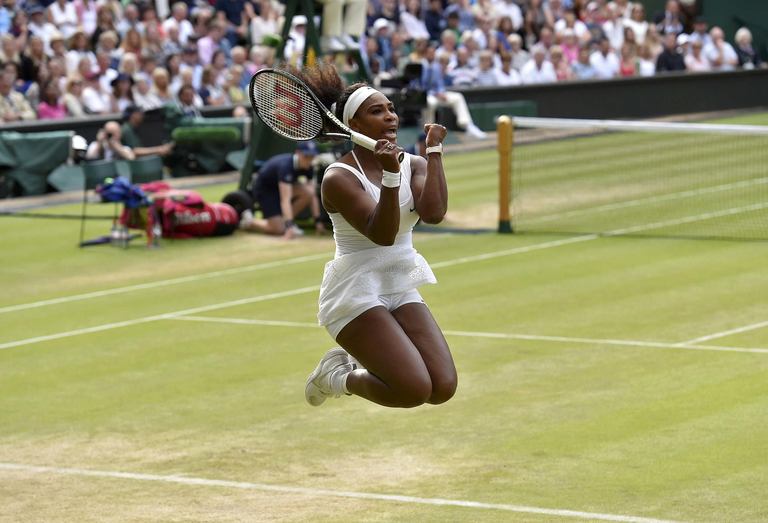 Serena Williams of the U.S.A. celebrates after winning her match against Victoria Azarenka of Belarus at the Wimbledon Tennis Championships in London, July 7, 2015.