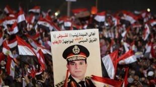 Pour le 3e anniversaire de la révolte de 2011, les portraits d'al-Sissi étaient brandis dans des manifestations de soutien au pouvoir en place. Le Caire, le 25 janvier 2014.