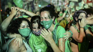 Pro-choice activists celebrate after the Senate approved a bill to legalize abortion outside the Congress in Buenos Aires.