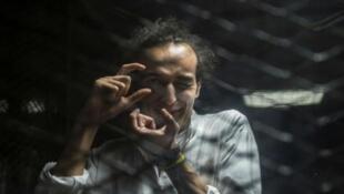 Mahmoud Abu Zeid, dit «—Shawkan—», photographié durant son procès au Caire le 9 août 2016.