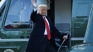 US President Donald Trump waves as he boards Marine One to depart the White House for the final time on January 20, 2021