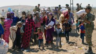 Refugiados sírios em campo na Turquia