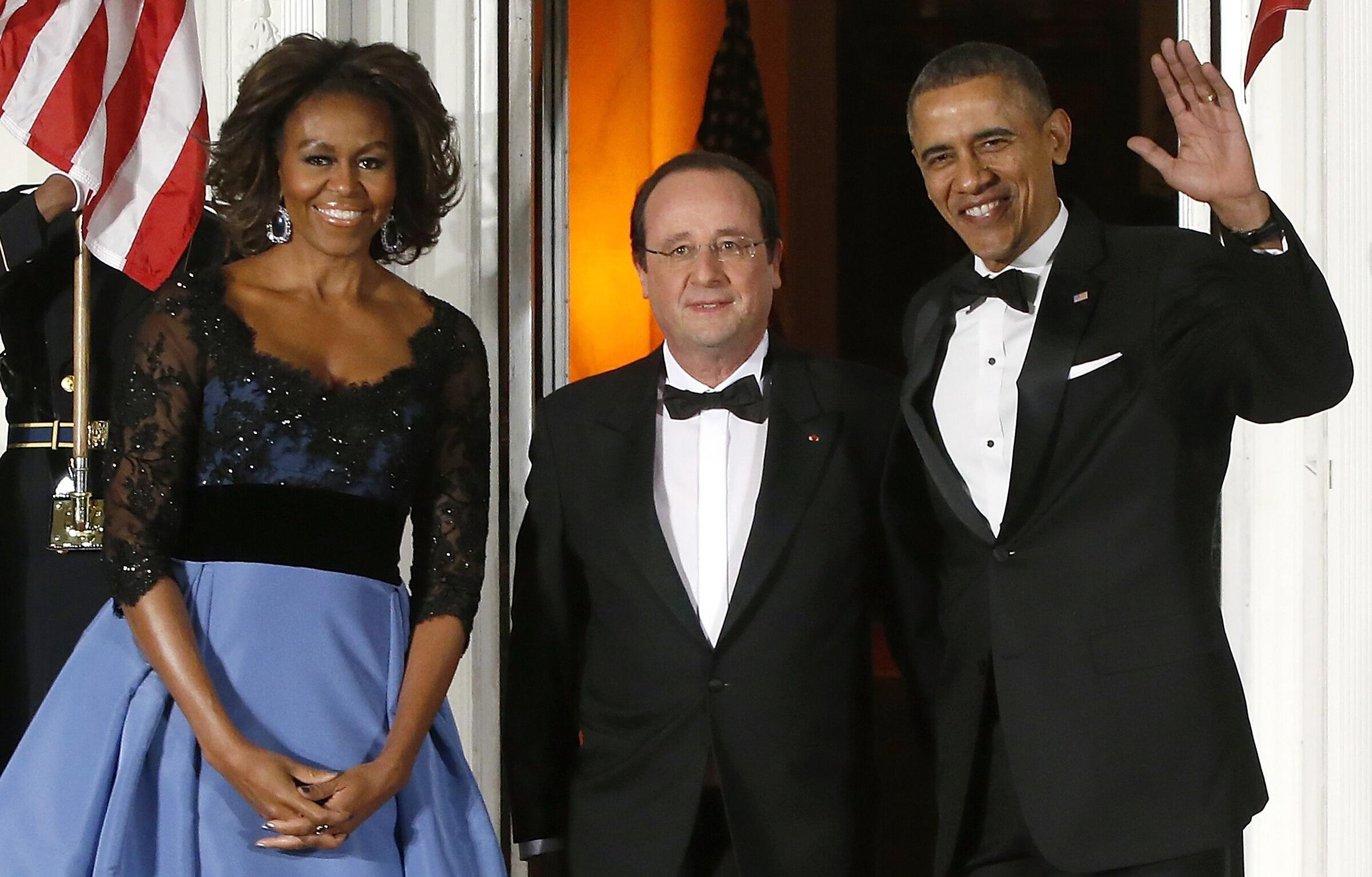 Barack Obama with his wife Michelle greet François Hollande at the White House