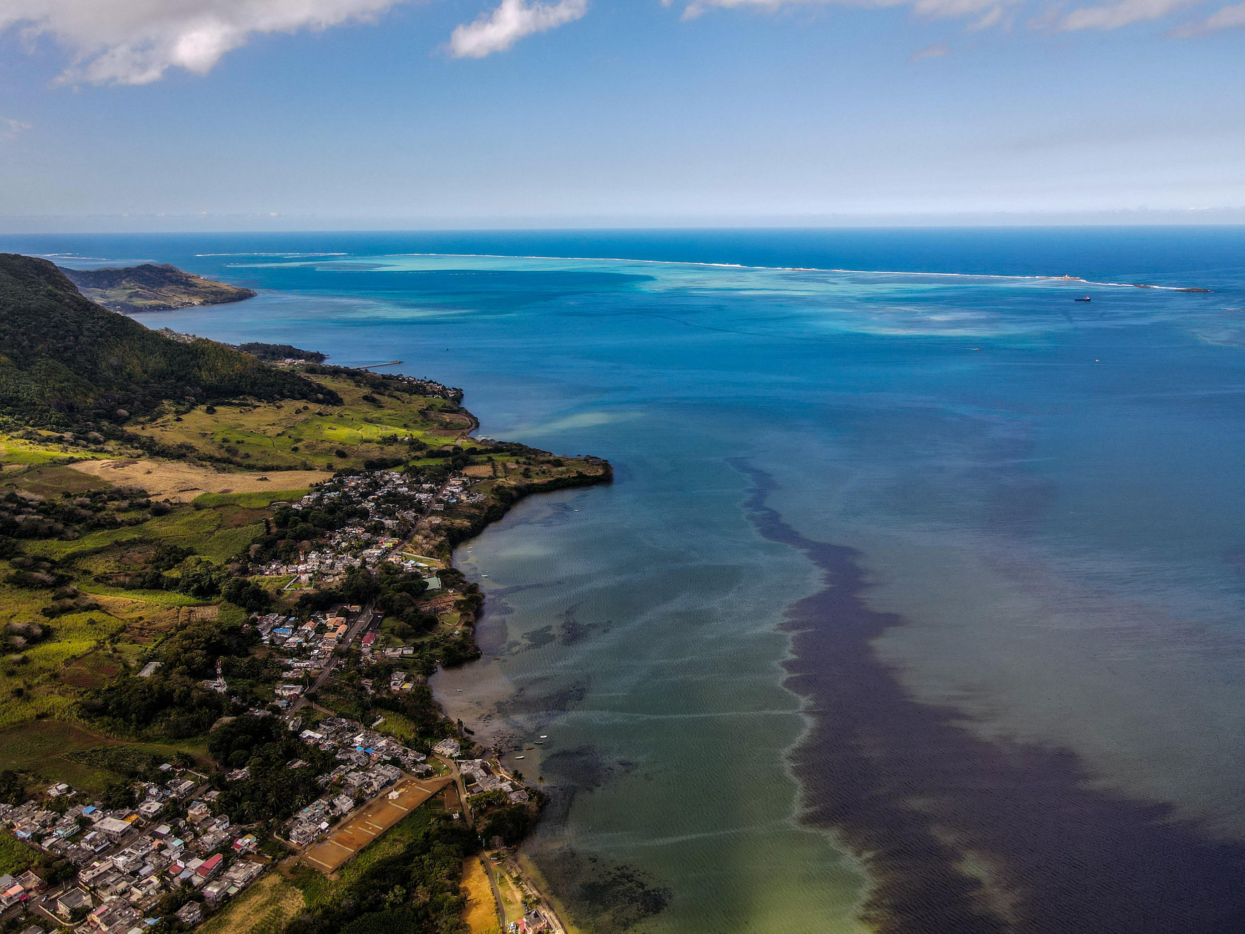 The Wakashio black oil spill moving sinuously off the coast of Vieux-Grand-Port, south east of Mauritius island.