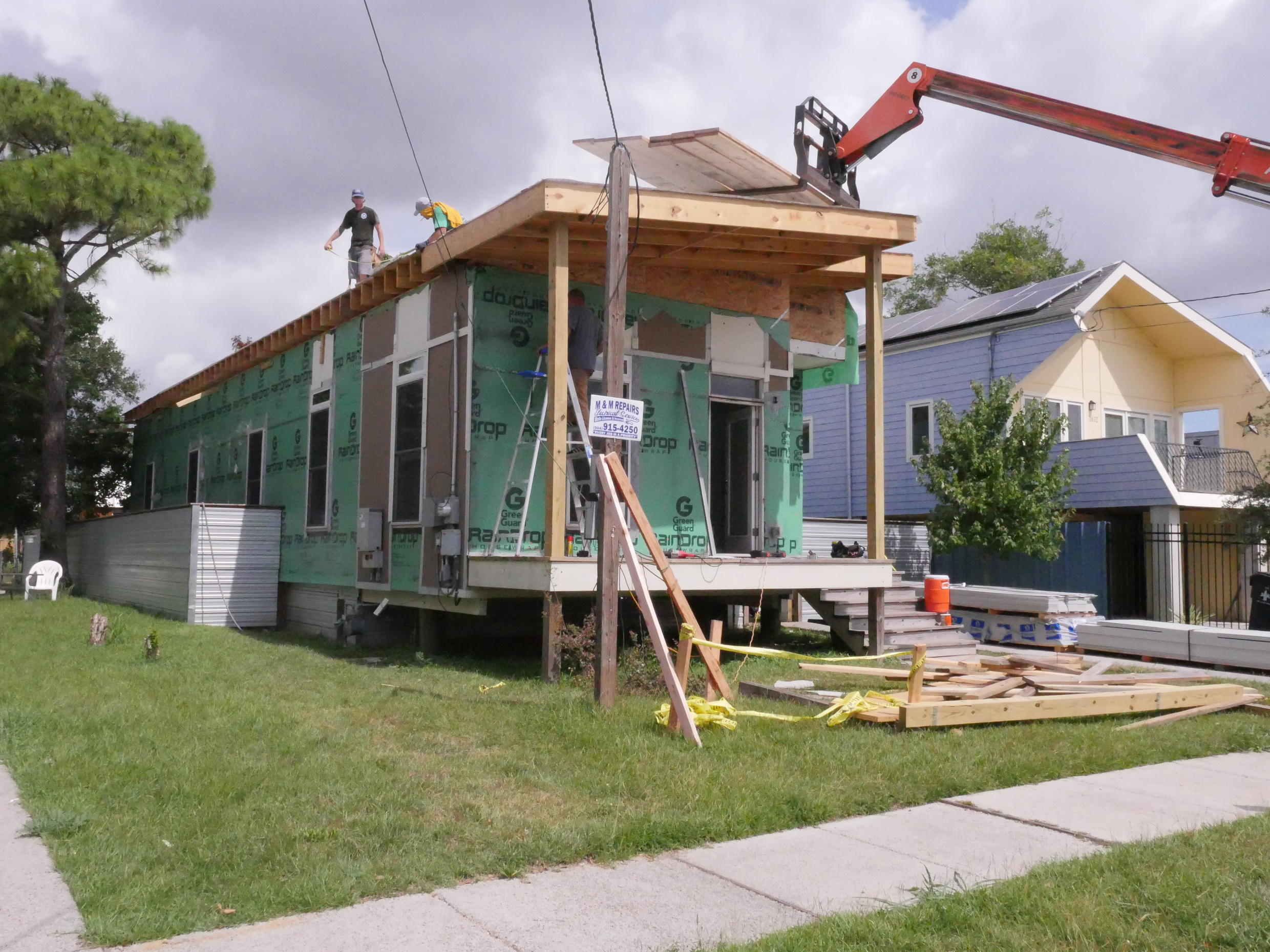 A worker on the roof of a house under construction in the Lower Ninth Ward.