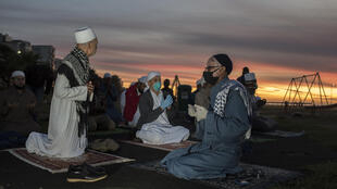 A small group of Muslim clerics gather for prayer before looking for the crescent moon which will signal the start of the month of Ramadan in Seapoint on April 23, 2020, in Cape Town; Muslims around the world are preparing to celebrate the start of the fasting month of Ramadan