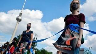Manifestation à Berlin John MacDoudall AFP