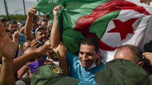 In this July 2 file photo, Karim Tabbou, one of the most prominent figures of Algeria's Hirak movement, is greeted upon his release from Kolea Prison near Tipasa, 70 kilometres west of the capital Algiers