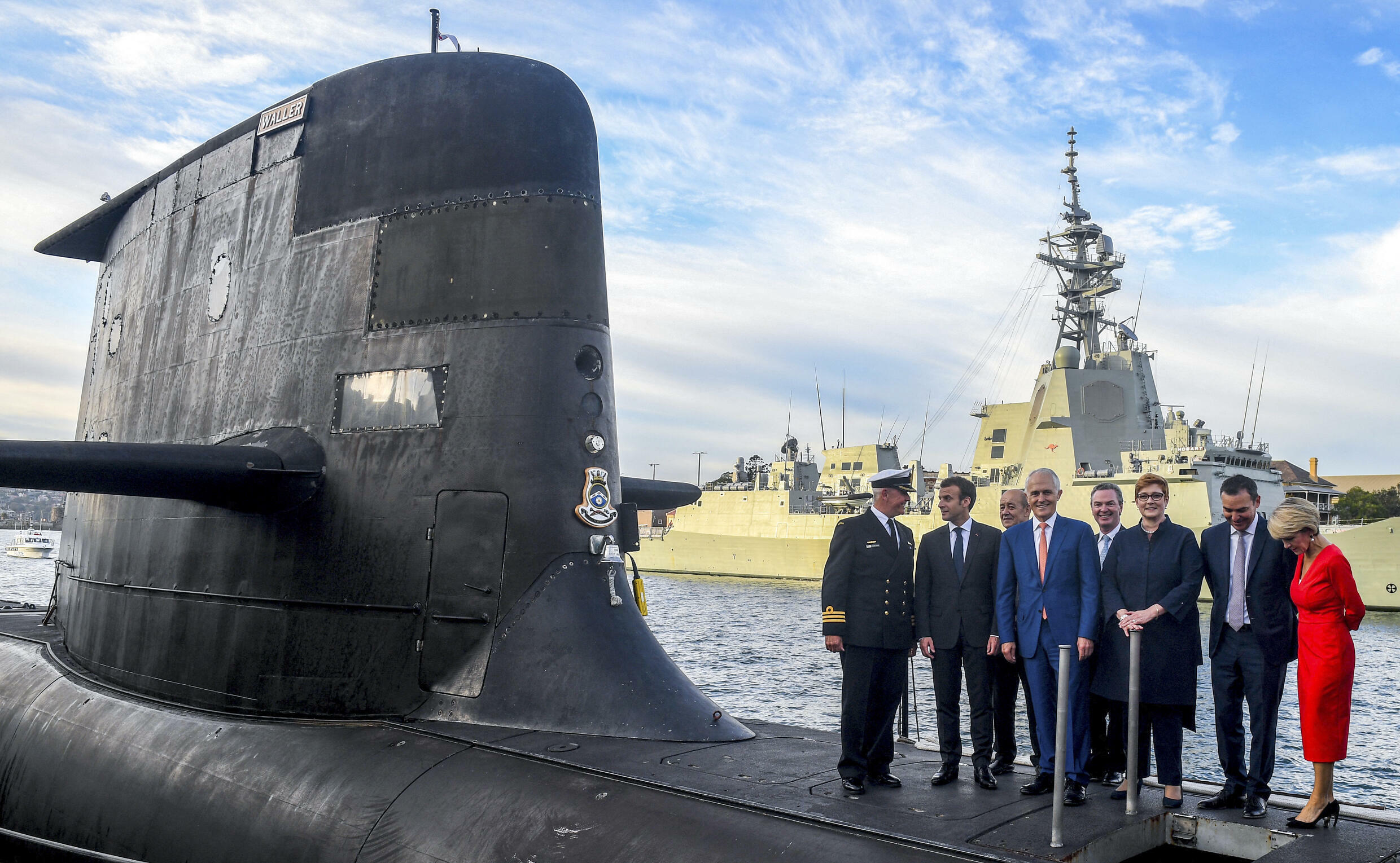 French President Emmanuel Macron tours the deck of a submarine with Australia's then prime minister Malcolm Turnbull in Sydney in May 2018