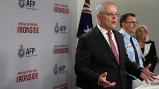 Australia's Prime Minister Scott Morrison announces details of the international operation
