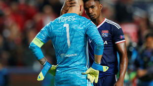 Lyon midfielder Thiago Mendes consoles goalkeeper Anthony Lopes after his blunder gifted Benfica a late winner.