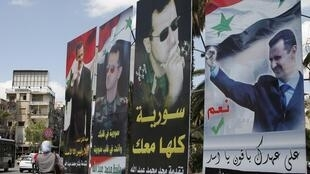 Portraits des candidats à la présidentielle, Damas, le 2 juin 2014.