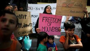 Ảnh minh họa : Người xin tỵ nạn Syria biểu tình ở Athens, Hy Lạp đòi được nhanh chóng đoàn tụ với người thân ở Đúc.