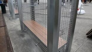 Fences built around benches to prevent homeless people from using them in Angouleme, a town in southwest France.