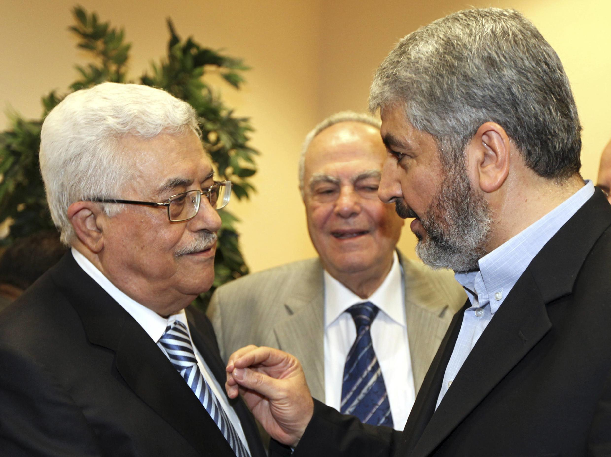Palestinian President Mahmud  Abbas with Hamas's Khaled Meshaal in Cairo last May