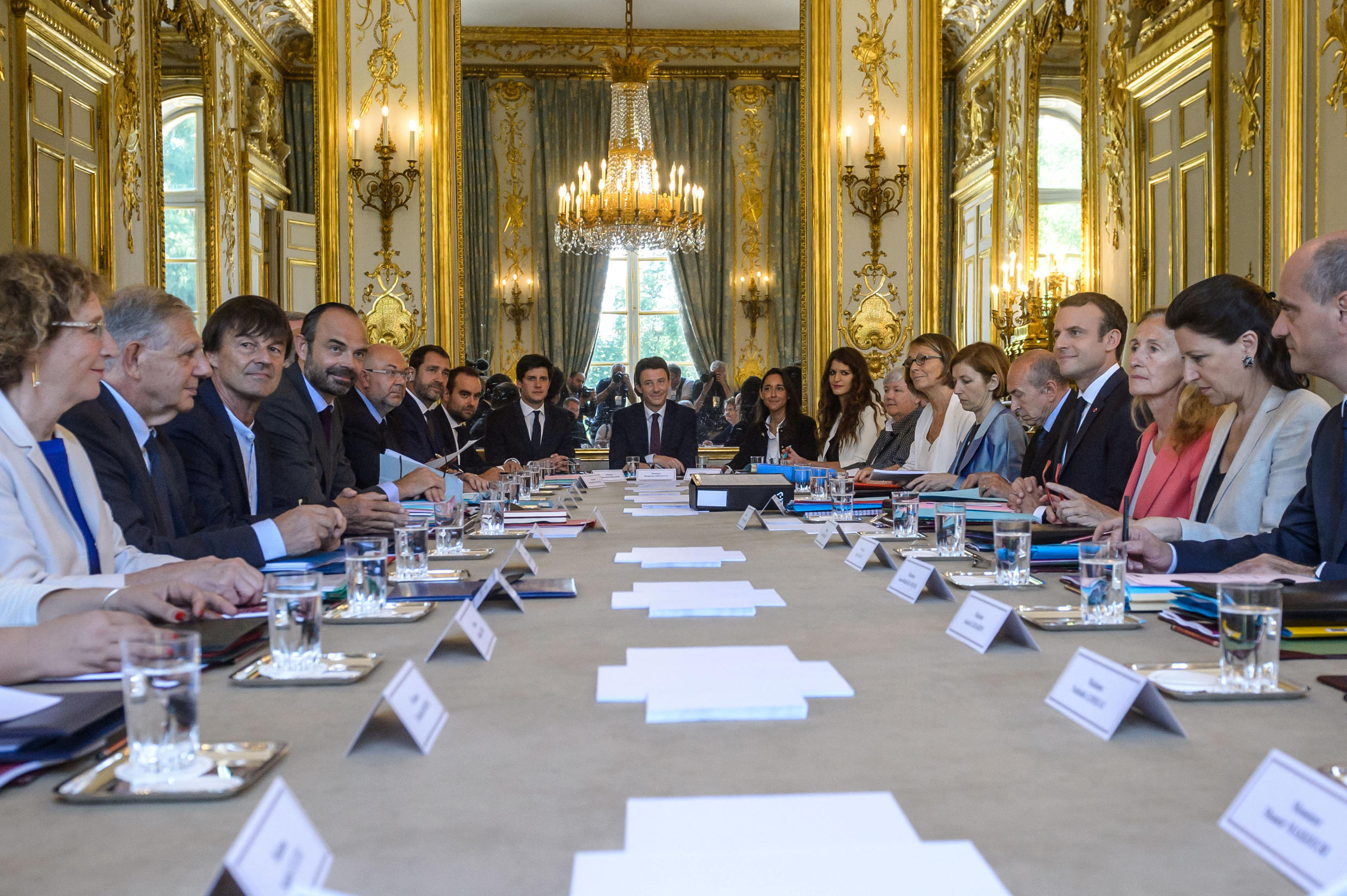 French President Emmanuel Macron (C) attends the weekly cabinet meeting with new government members after a reshuffle at the Elysee Palace in Paris, France, June 22, 2017.