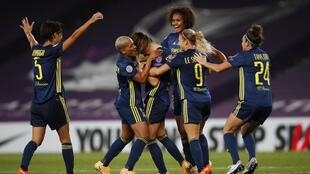 Lyon celebrate Sara Bjork Gunnarsdottir's goal against Wolfsburg in the UEFA Women's Champions League final in San Sebastian, Spain, 30 August 2020.