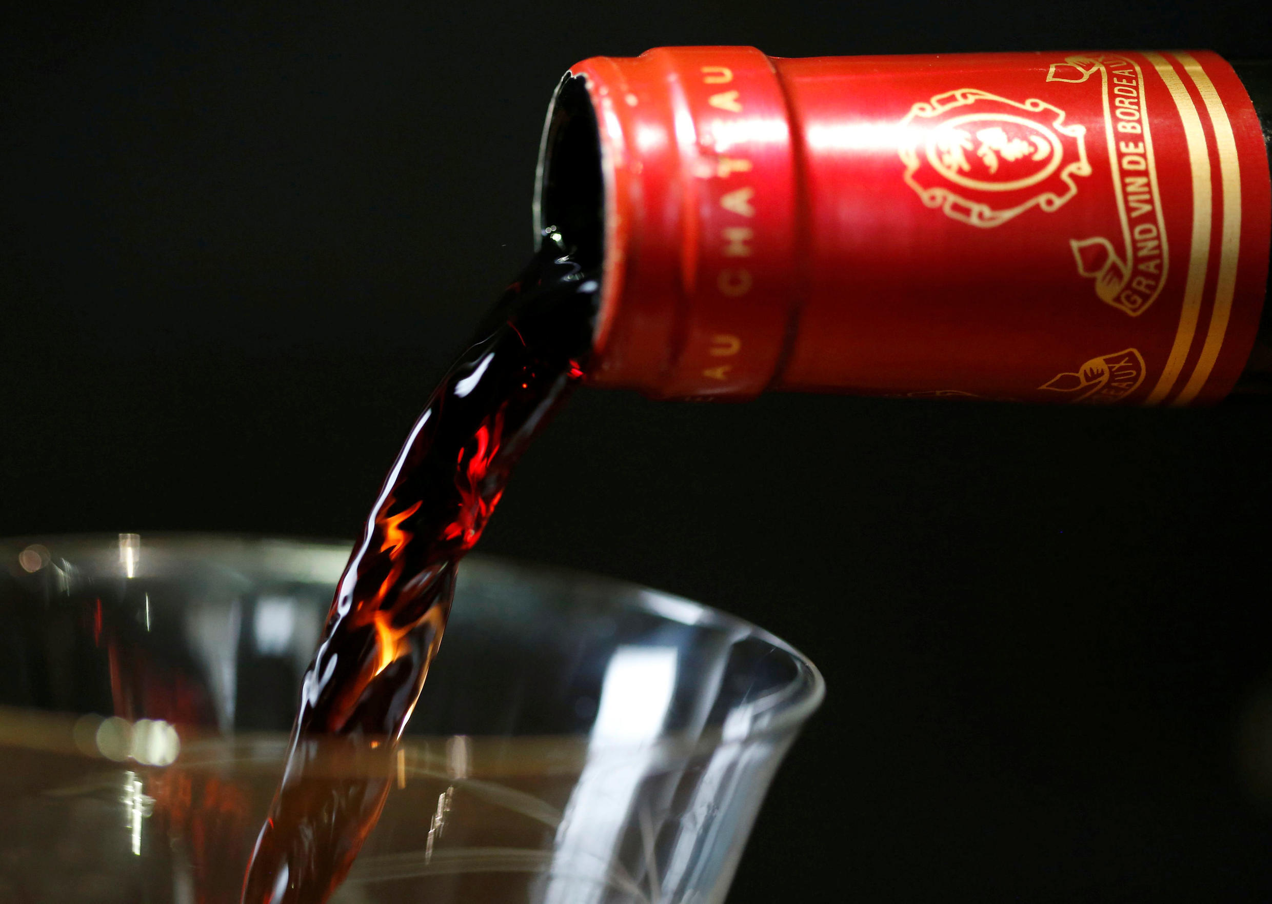 A bottle of the 2017 Bordeaux Chateau Malartic-Lagraviere is poured at a primeurs fair this year