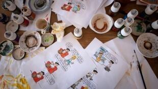 Les planches du dessinateur Julien Berjeaut alias Jul, dans son atelier à Paris.