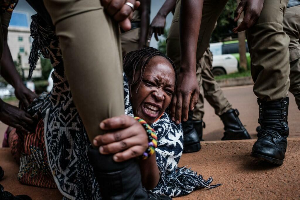 Stella Nyanzi (C), a prominent Ugandan activist and government critic, is arrested by police officers after she tried to distribute food to people hit financially hard by the Covid-19 lockdown in Kampala, on May 18, 2020.