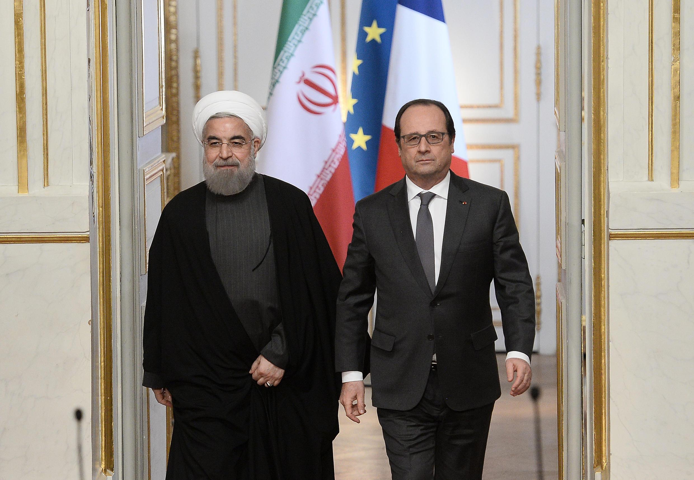 Hassan Rohani (esquerda ), presidente iraniano, e François Hollande (direita), presidente francês.
