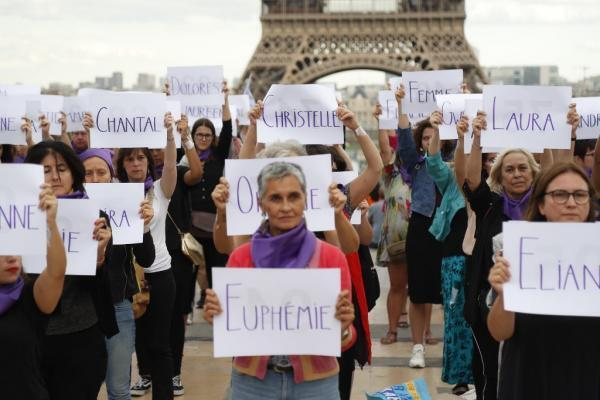 People hold placards with names of women during a demonstration called to denounce the 100th femicide of the year, on September 1, 2019 in Paris.