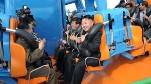 North Korean leader Kim Jong-Un prepares to take a ride during the opening ceremony of the Rungna People's Pleasure Ground, 25 July, 2012