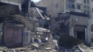 7月23日,大馬士革市區南部,轟炸後的街區。