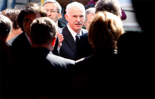 Greece's Prime Minister George Papandreou arrives in Brussels ahead of a European Union leaders summit in Brussels on 25 March