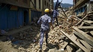 Nepalese police to rescue earthquake victims, Sankhu, Nepal, 12 May 2015.