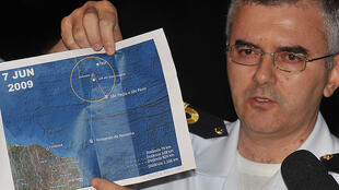 Brazilian Navy Commander Giucemar Tabosa Cardoso shows a satellite picture with the location of the wreckage