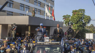 Peter Mutharika, leader of Malawi's Progressive party (left in truck) stands with his former running mate Atupele Muluzi.